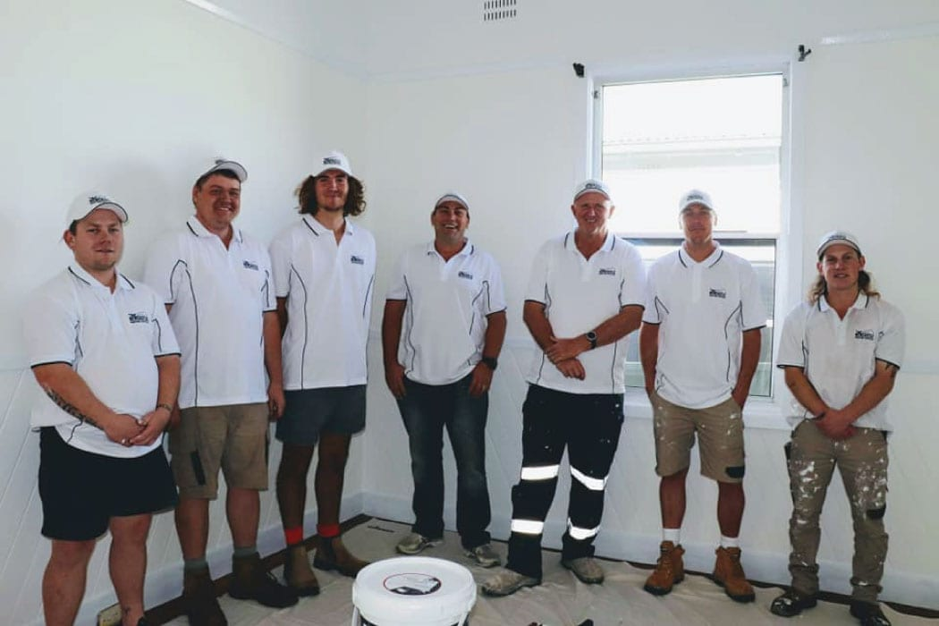 Newcastle Painting Services team in a house they just painted