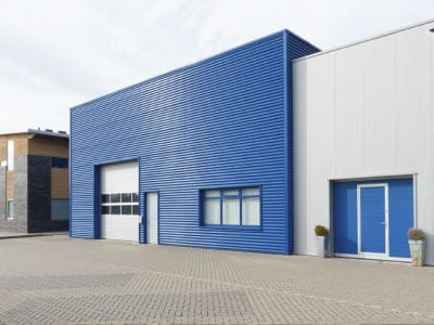Commerical building painted blue with white roller door
